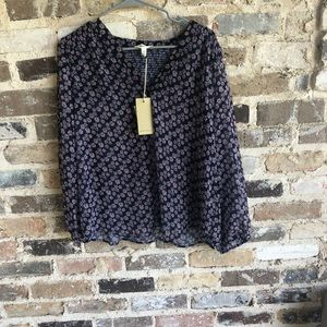 A  dark blue blouse with flowers.